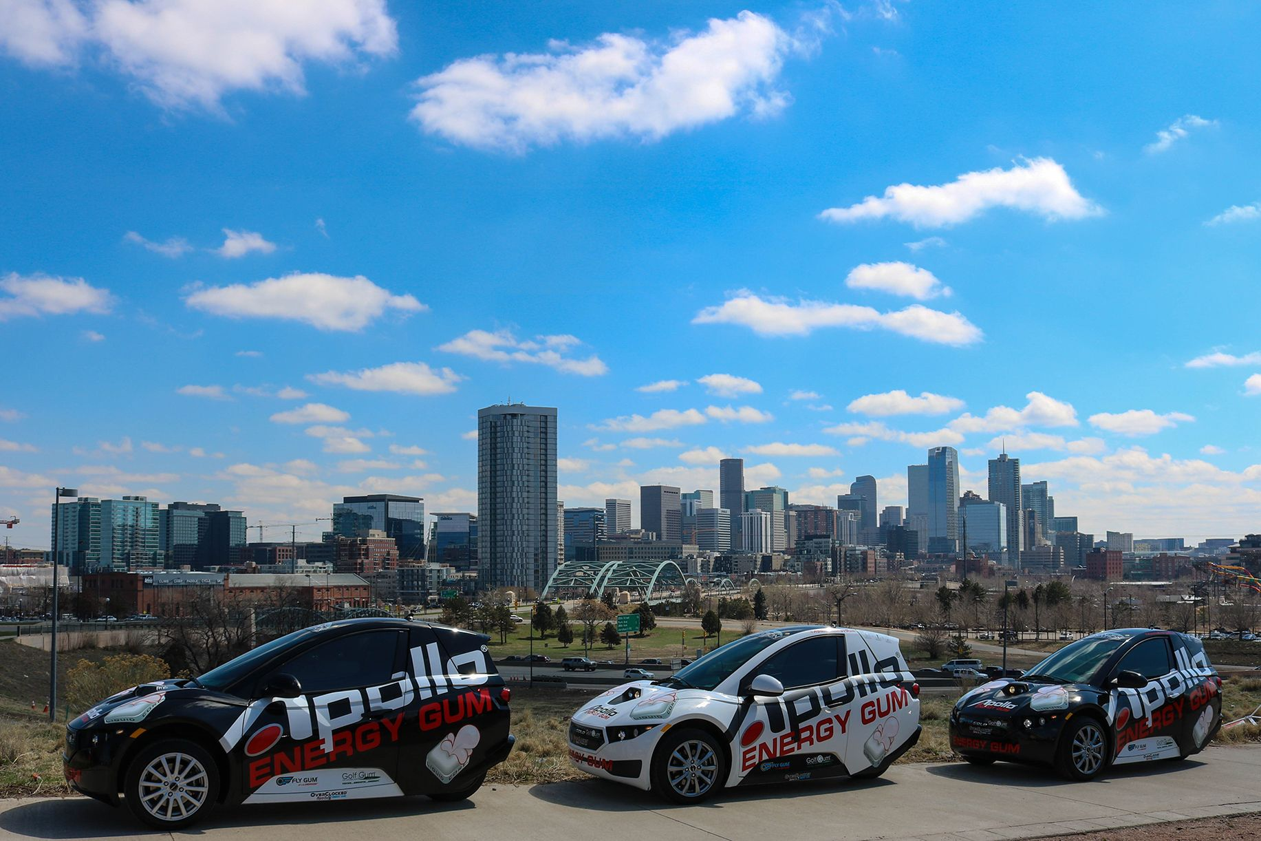 Denver Skyline with Apollo SOLO Fleet Vehicles