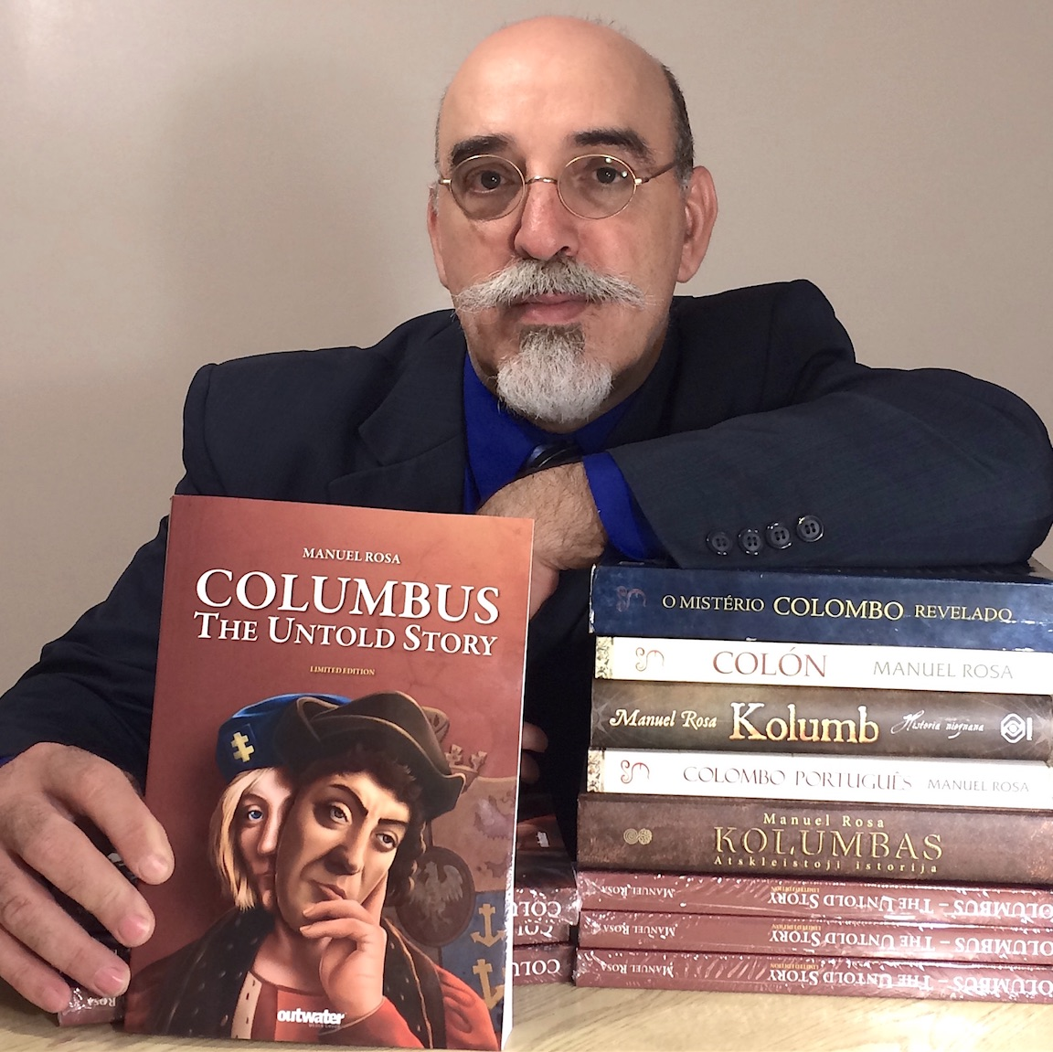 Investigative historian, Manuel Rosa, with some of his book titles.
